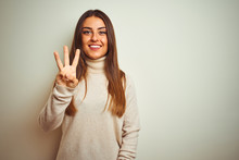 Young Beautiful Woman Wearing Winter Turtleneck Sweater Over Isolated White Background Showing And Pointing Up With Fingers Number Three While Smiling Confident And Happy.