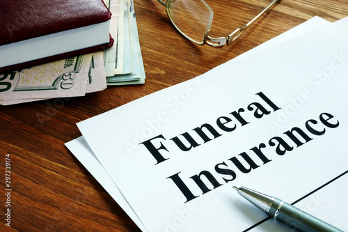 Photo Funeral insurance agreement, money and glasses.