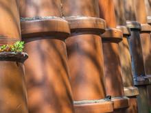 Closeup Of Brown Clay Pots Bac...