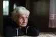 Leinwandbild Motiv Portrait of sad elderly woman in the his house.