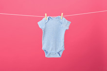 Baby Onesie Hanging On Clothes...
