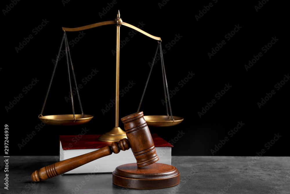 Fototapety, obrazy: Judge's gavel, book and scales on grey table against black background, space for text. Criminal law concept