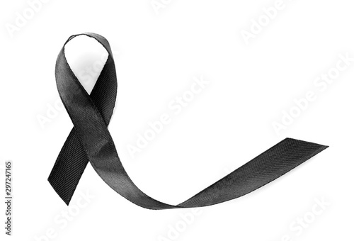 Photo  Black ribbon on white background, top view. Funeral symbol