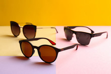 Stylish Sunglasses On Color Background. Summer Time