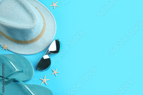 Fototapeta Flat lay composition with sunglasses and beach accessories on blue background. Space for text obraz na płótnie