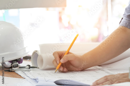 architect working and sketching architectural drawing plan on table Tablou Canvas