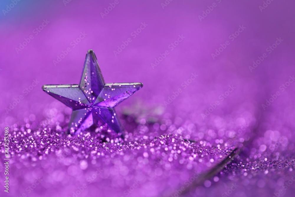 Fototapety, obrazy: Christmas background.Violet star close-up on a lilac glitter background on a blurry purple background.