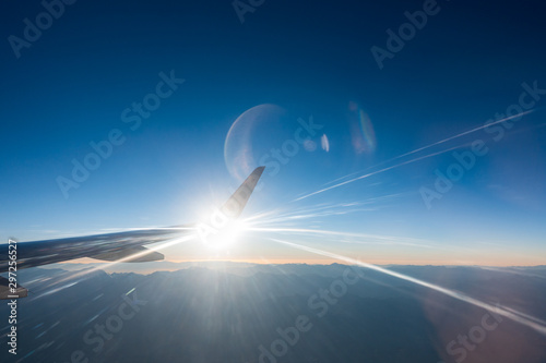 Photo Light beams in jet airplane wing flying