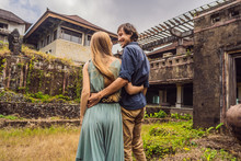 Happy Couple In Love In Abandoned And Mysterious Hotel In Bedugul. Indonesia, Bali Island. Honeymoon In Bali