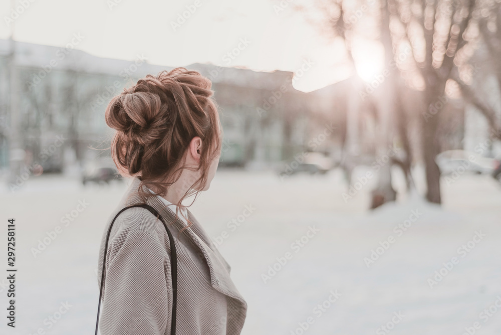 Fototapety, obrazy: portrait of a beautiful girl in a coat in the winter. walking photo shoot in winter.  young attractive girl with red hair in winter season on city background. staged photo shoot on the street