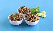 Black Eyed Beans Or Cowpea Curry, An Indian Vegetarian, Delicious, And Healthy Home Cooked Side Dish For Food Like Chapati And Roti, In Three Bowls, And Coriander Leaves And Lemon Slices.