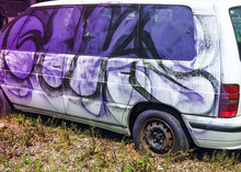 Crashed Car With Graffiti On T...