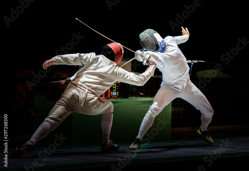 Photo Fight at a fencing competition.
