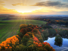 Amazing Sunset Over The Autumnal Forest And Lake In Poland