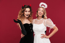 Positive Women Angel And Demon In Carnival Costumes