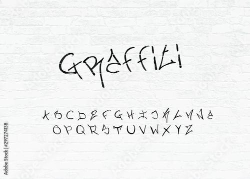 Photo  Graffiti Font Letters On Brick Wall Vector Illustration