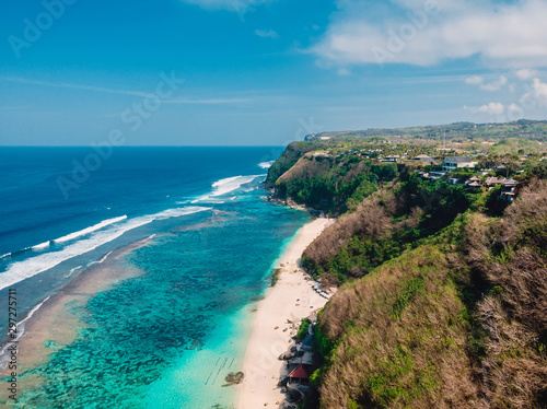 Beautiful cliff and beach with ocean in Bali, aerial view