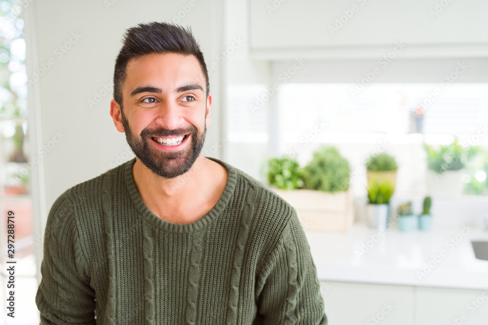 Fototapeta Handsome man smiling cheerful with a big smile on face showing teeth, positive and happy expression