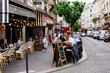 canvas print picture Cozy street with tables of cafe in quarter Montmartre in Paris, France
