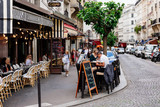 Fototapeta Fototapety Paryż - Cozy street with tables of cafe in quarter Montmartre in Paris, France