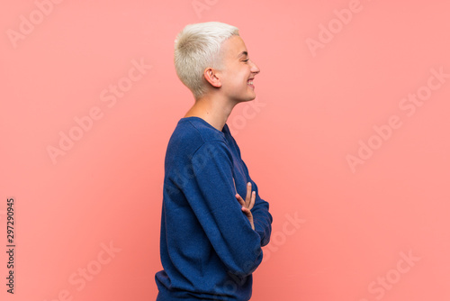 Obraz Teenager girl with white short hair over pink wall in lateral position - fototapety do salonu