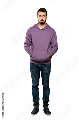 Full-length shot of Handsome man with sweatshirt with sad and depressed expression over isolated white background