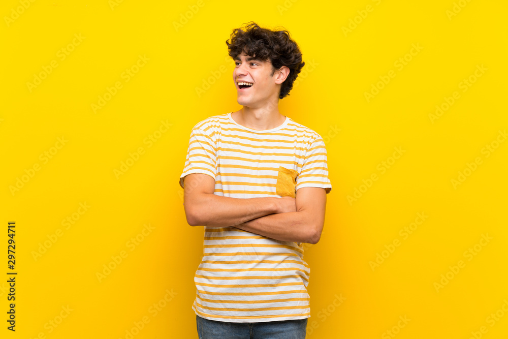 Fototapety, obrazy: Young man over isolated yellow wall happy and smiling