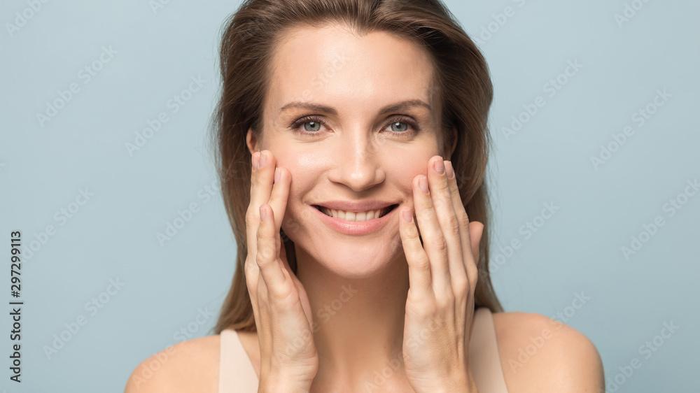 Fototapeta Smiling millennial woman touch healthy breathing skin