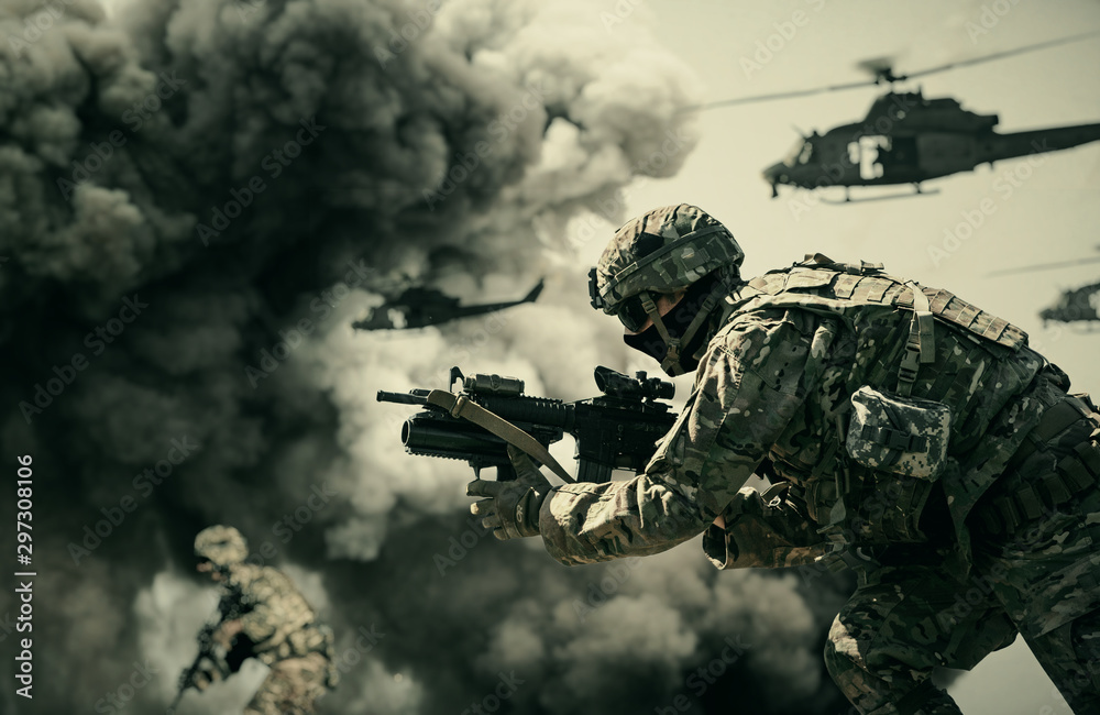 Fototapeta Military helicopter and forces between fire and dust in the battlefield