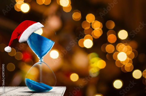 Christmas countdown. Modern Hourglass with space for text sand trickling through the bulbs of a crystal sand glass. Holiday themed image.
