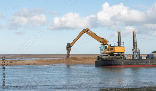 Valokuvatapetti Dredger dumping sand on a bank