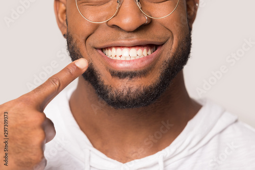Close up of biracial man show white healthy teeth - 297309373
