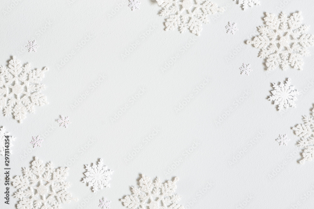 Fototapety, obrazy: Christmas composition. Frame made of snowflakes on pastel gray background. Christmas, winter, new year concept. Flat lay, top view, copy space