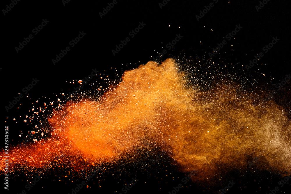 Fototapety, obrazy: Abstract orange powder explosion isolated on black background.