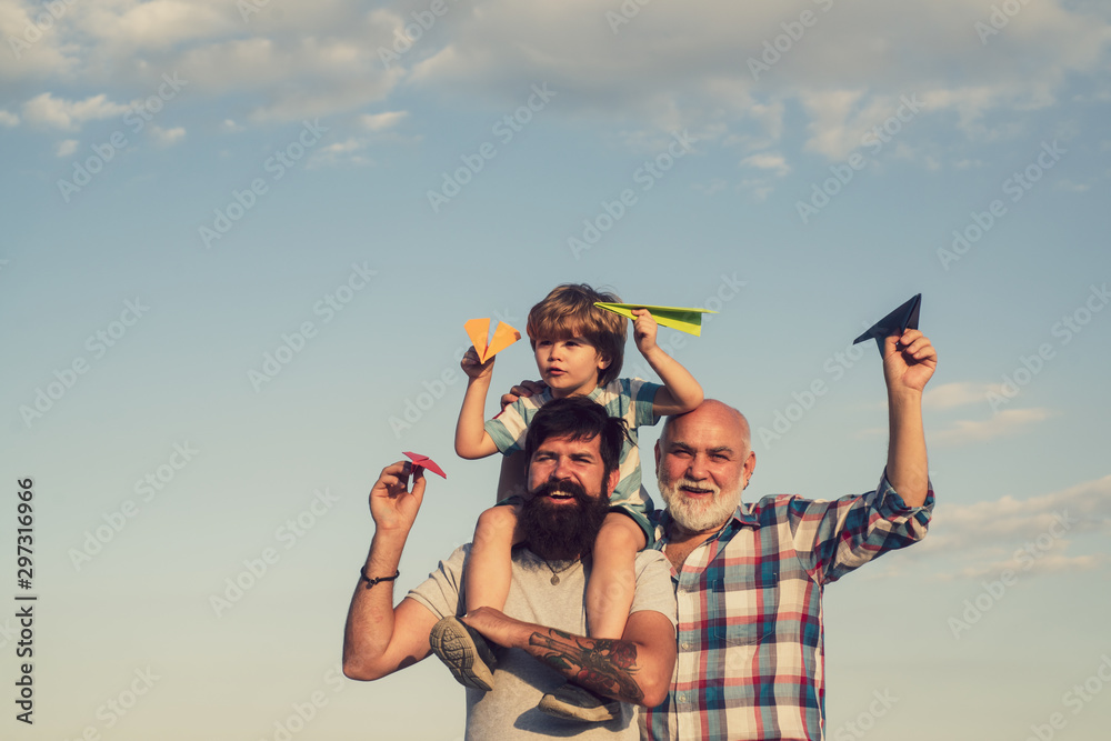 Fototapety, obrazy: Happy man family have fun together. Weekend family play. Fathers day - grandfather, father and son are hugging and having fun together.