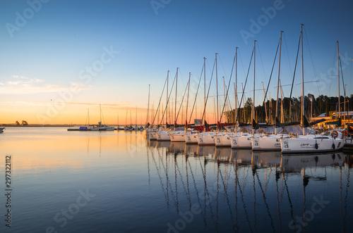 Boats docking in the marina at the Niegocin Lake during sunrise Obraz na płótnie