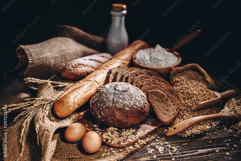 Fototapety, obrazy: Whole wheat bread and home cooking ingredients that are healthy and nutritious.