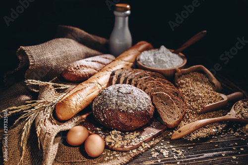 Fotobehang Brood Whole wheat bread and home cooking ingredients that are healthy and nutritious.