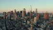 Flying towards Lower Manhattan Downtown business district at sunrise, skyline of New York with morning light