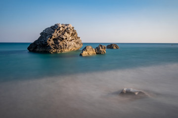 Big rocks in the sea at the beach at Kastri, Crete, Greece, long exposure