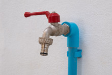 Tap Or Valve And Blue Pipe