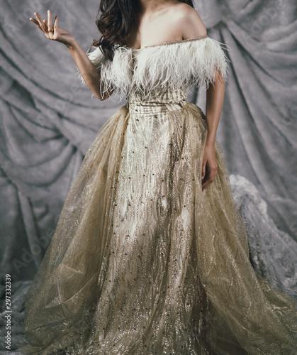 Obraz na płótnie elegant woman in golden yellow long gown evening dress