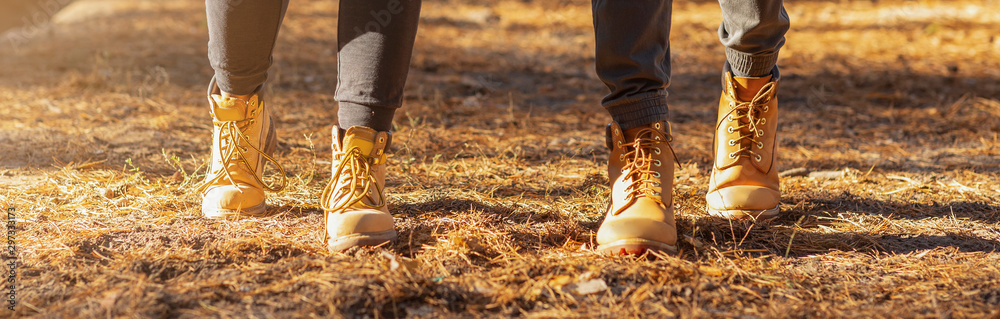 Fototapety, obrazy: Panoramic view of two human feet hiking in woods