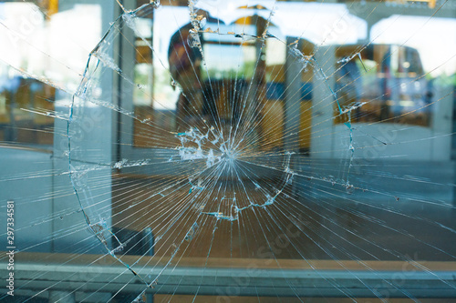 Broken Glass Pane. The broken glass window the shop Wallpaper Mural