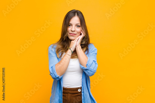 Fotomural  young pretty woman feeling in love and looking cute, adorable and happy, smiling