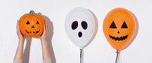 Halloween Balloons With Faces And Orange Pumpkin