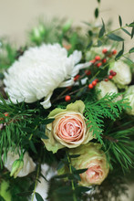 Close Up Winter Bridal Bouquet With White Roses, Chrysanthemum, Pine, Thuja, Ilex, Pistachio, Above Side View Of Stock Photo Image