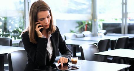 FototapetaYoung businesswoman on a coffee break talking on the phone