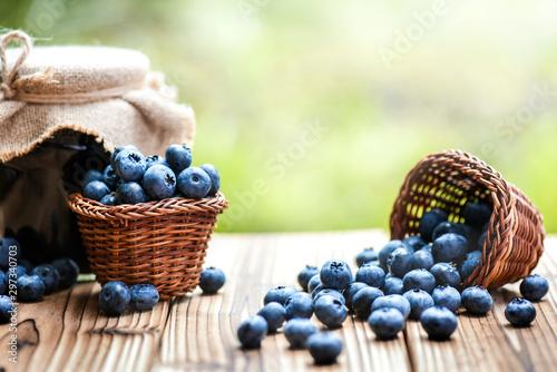 Obraz na płótnie Blueberries in wicker basket and blueberry jam or marmalade