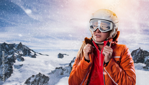 Photo young woman snowboarder wearing winter sports gear in wintry mountains environme